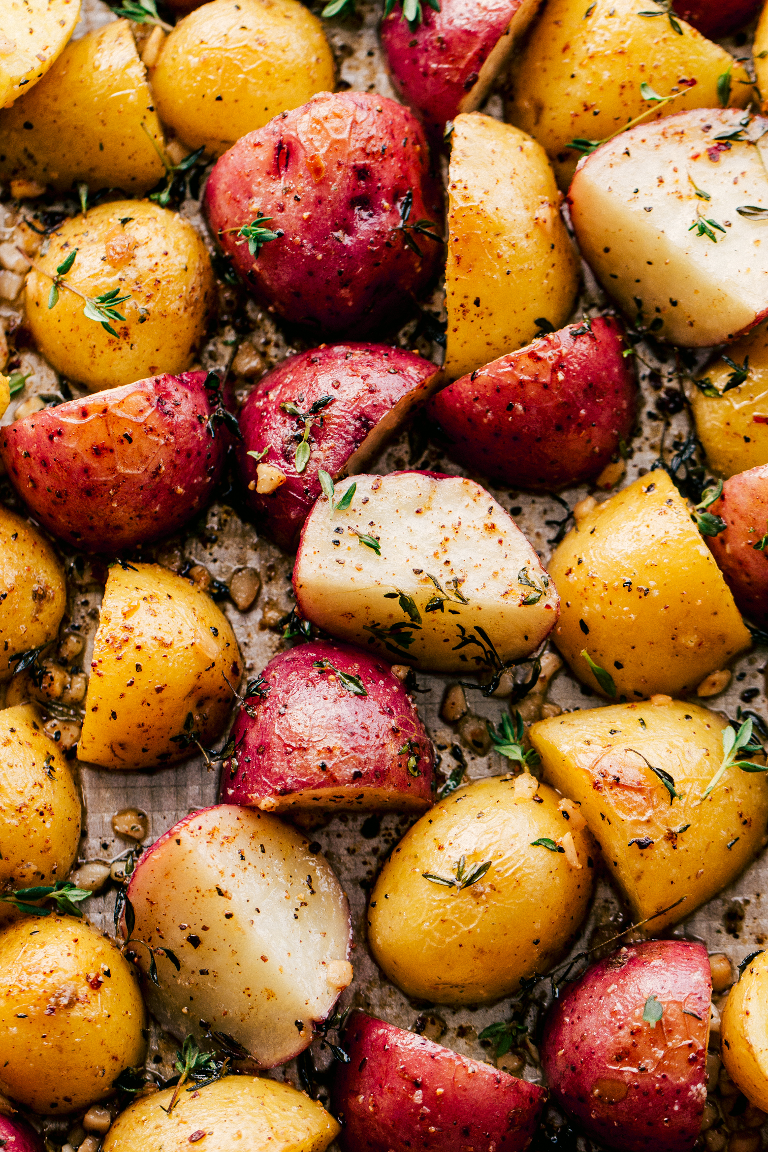 Roasted potatoes in garlic butter topped chopped rosemary by the food cafe.