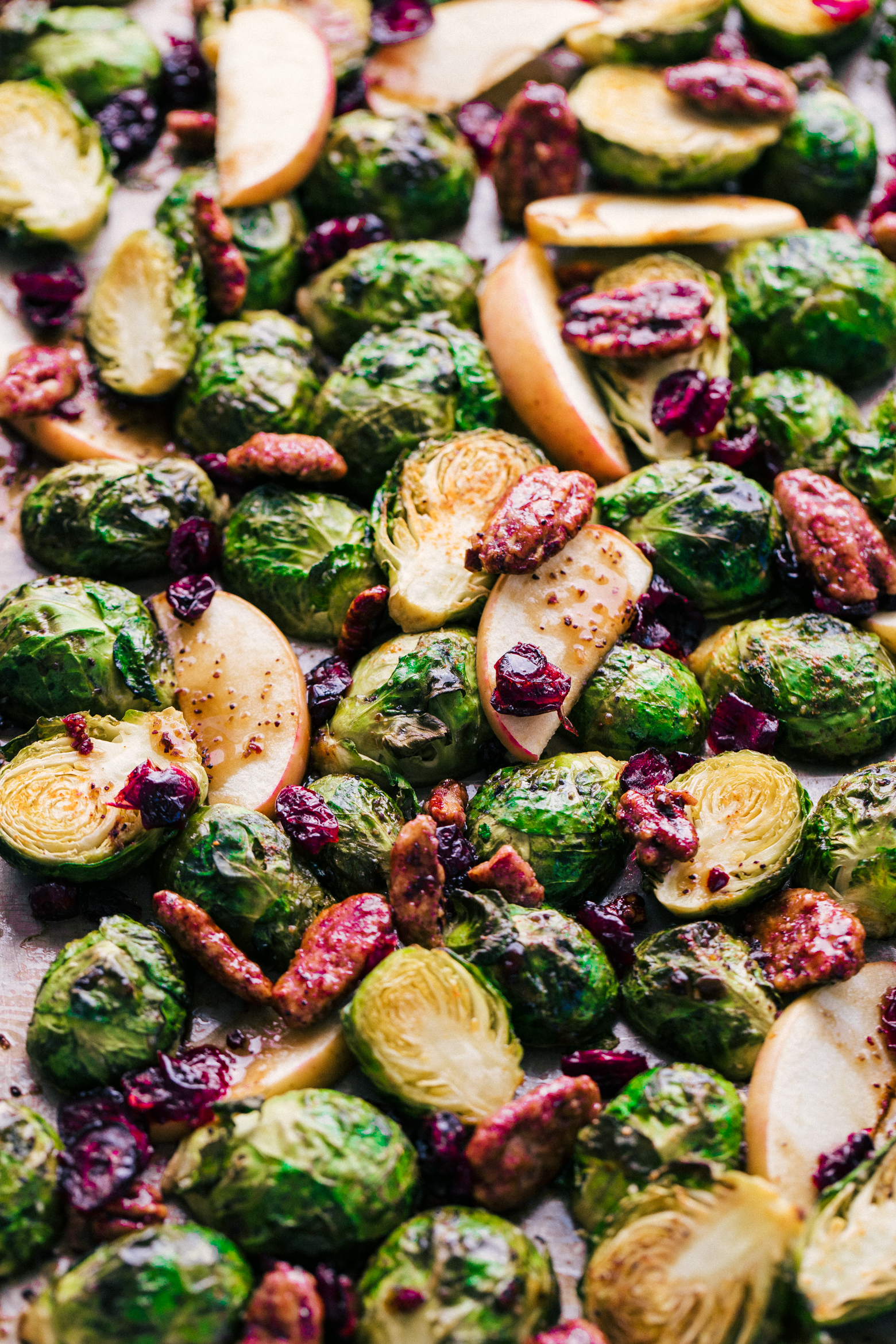 roasted brussels sprouts on a sheet pan with glazed pecans and crasins by The Food Cafe