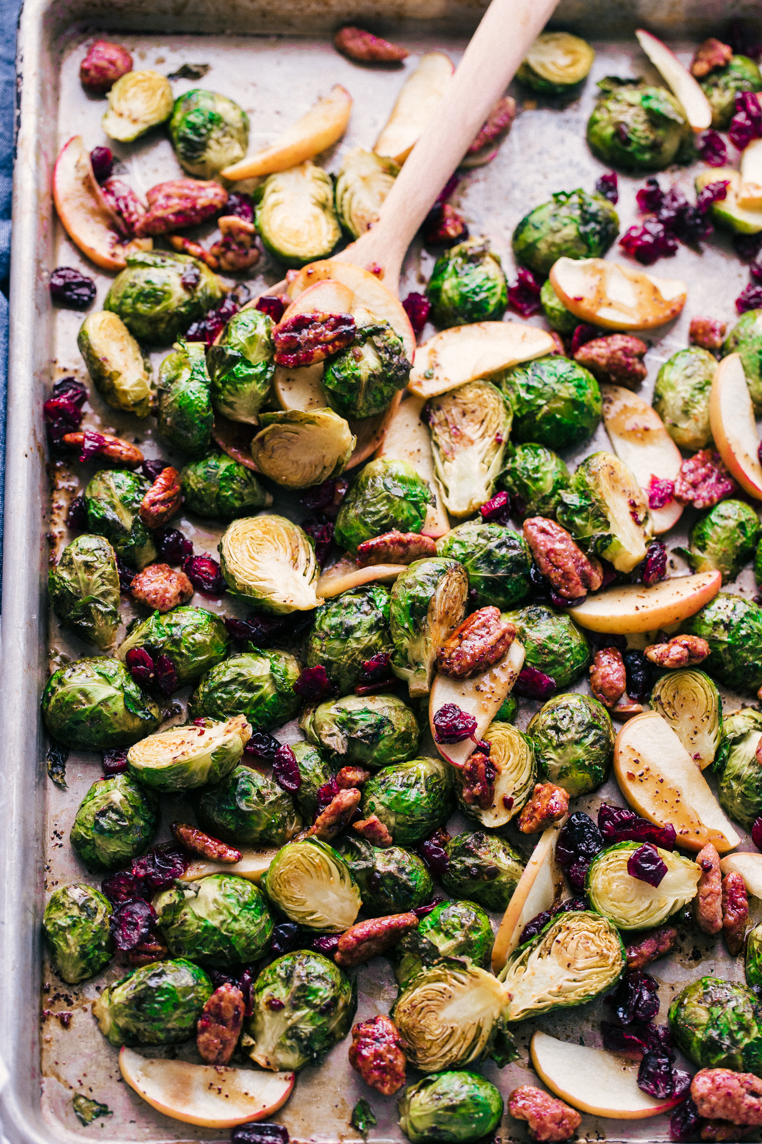 roasted brussels sprouts with balsamic dressing on a sheet pan by The Food Cafe