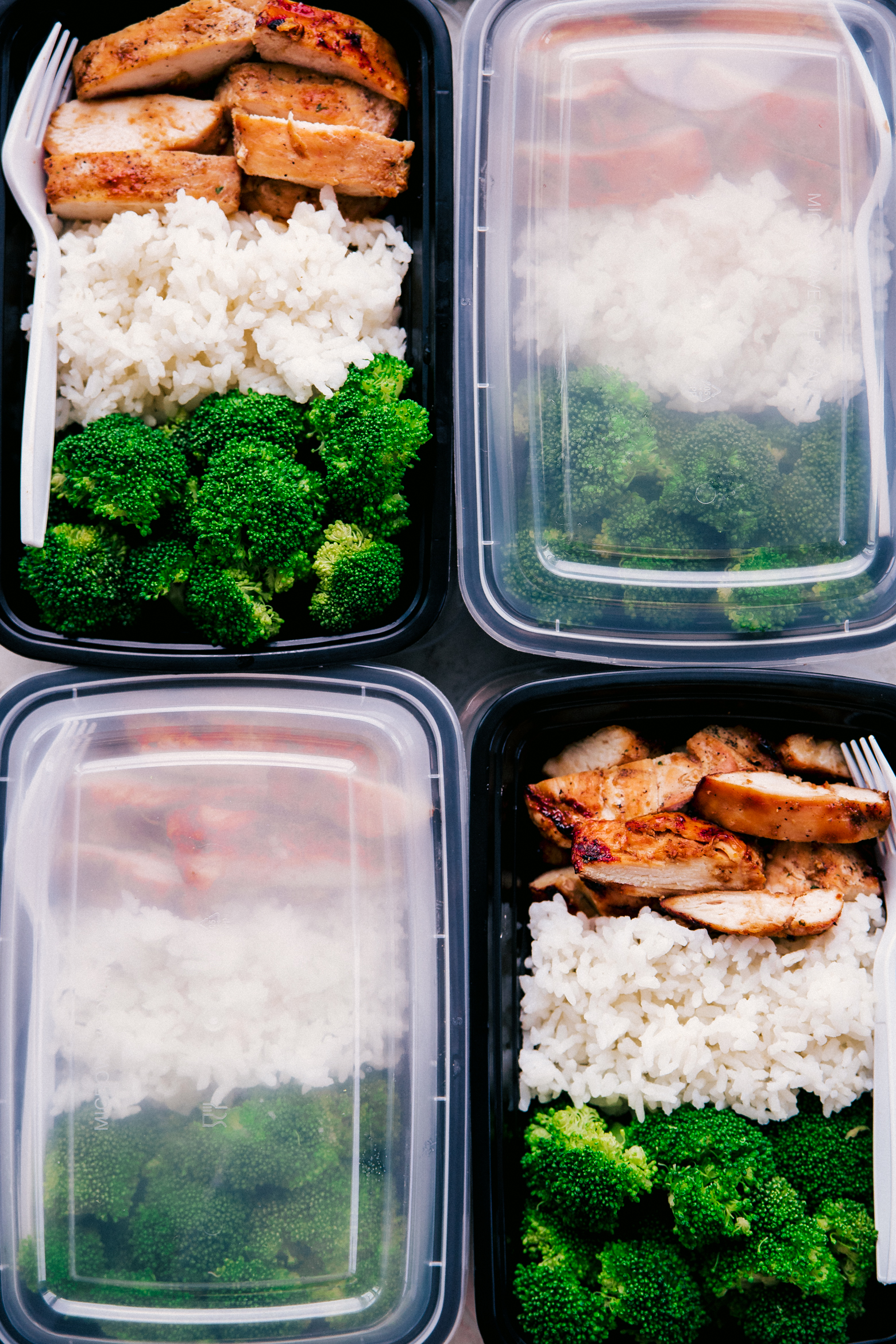 meal prep containers filled with teriyaki chicken, steamed broccoli, and white rice by The Food Cafe.