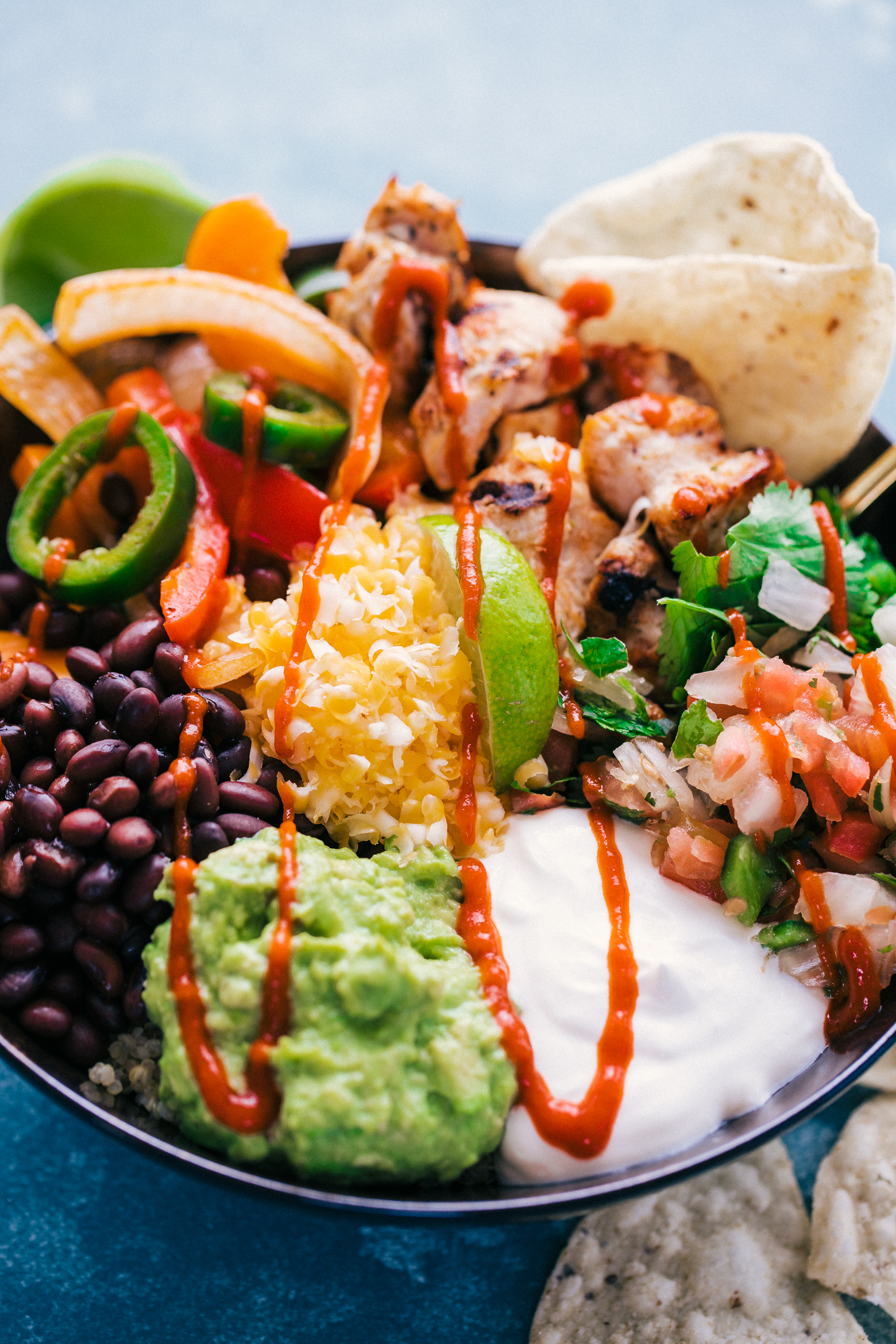Burrito Bowl recipe for easy meal prep served with all the fixings, by The Food Cafe.