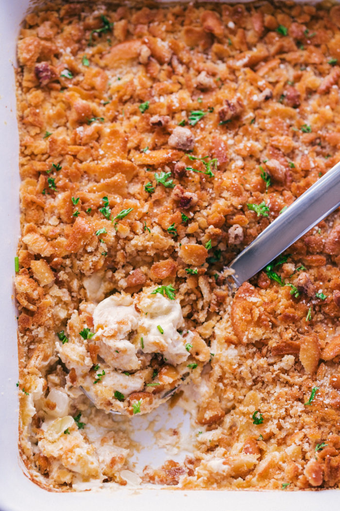 Chicken casserole, made in a white casserole dish and served up creamy and hot for dinner, by The food cafe