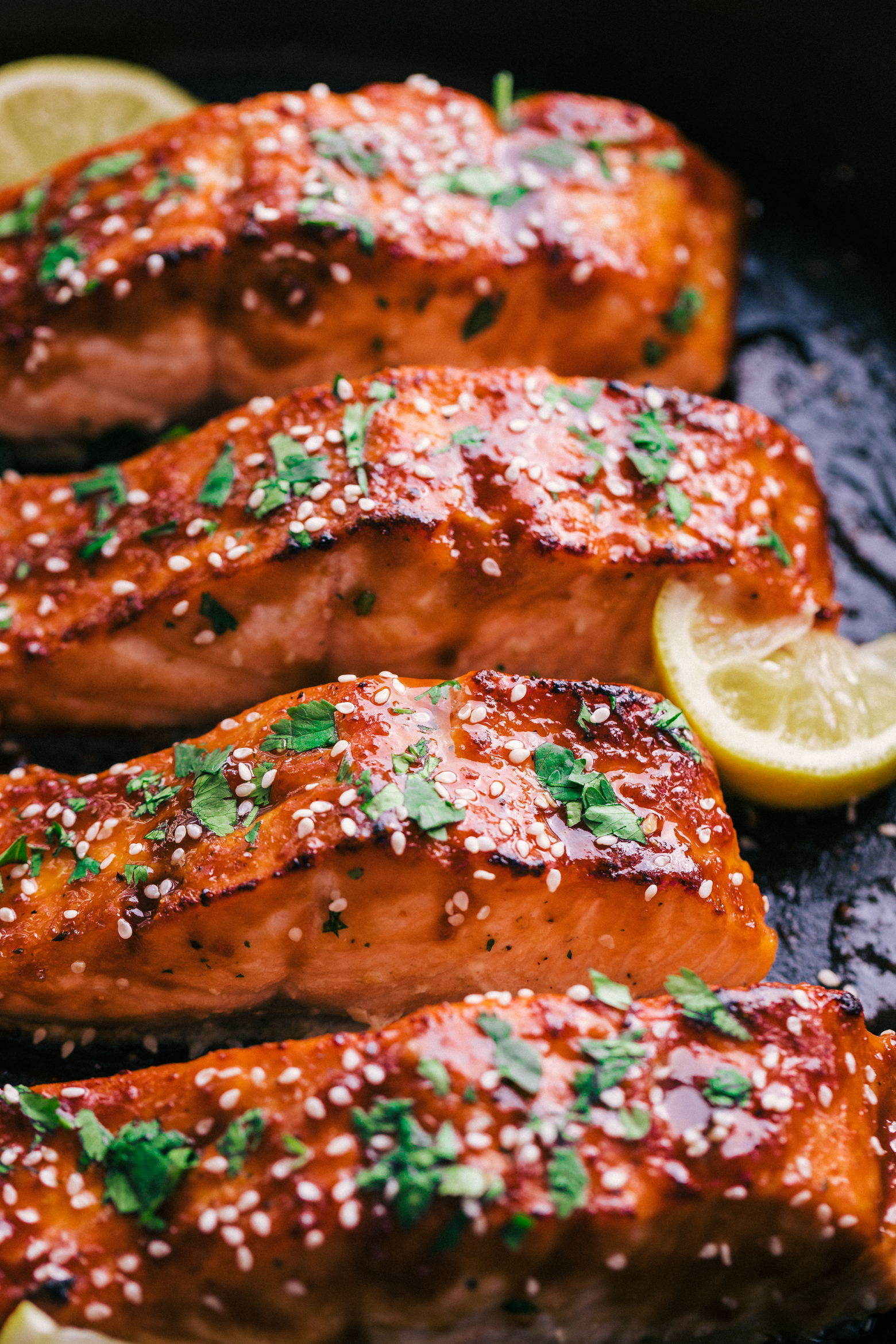 A delicious salmon recipe made with a maple glaze and cooked in a cast iron skillet by The Food Cafe.