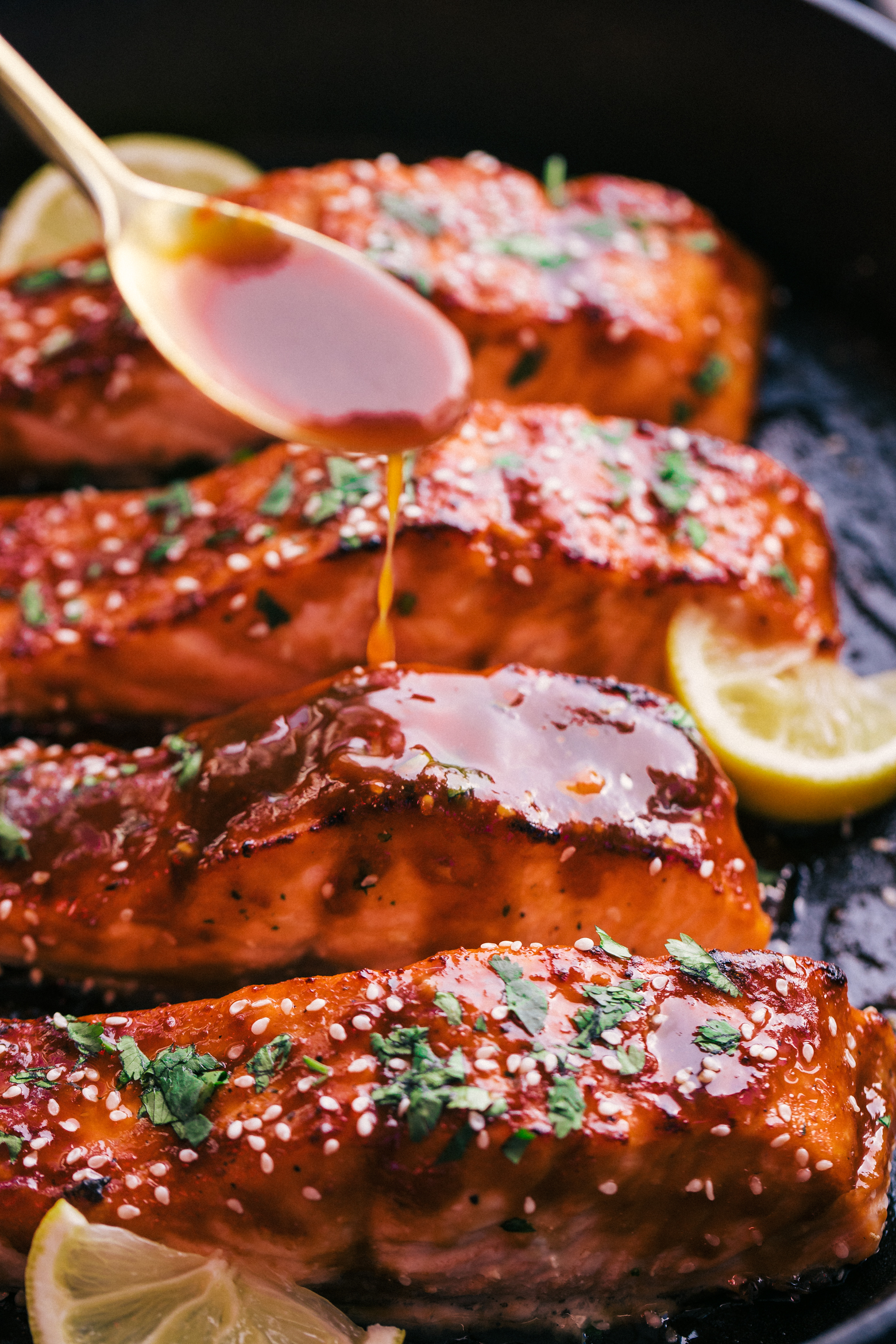 baked salmon cut into filets and tipped with maple glaze sauce by the food cafe.