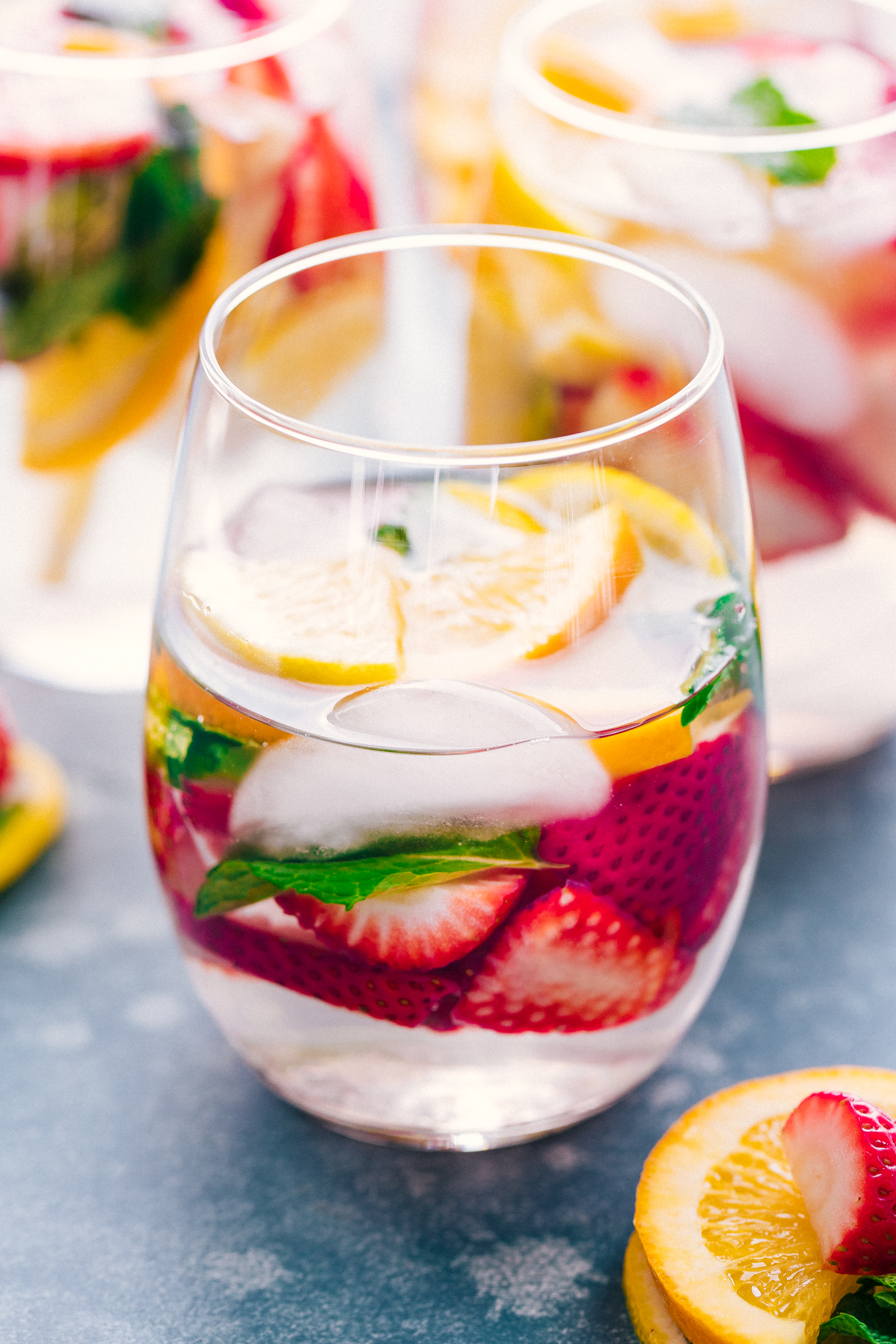 Detox Water with strawberries and lemons in a glass garnished with mint leaves