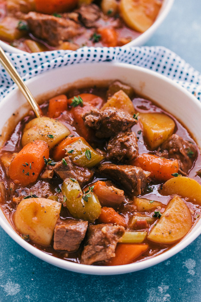Irish beef stew is the perfect recipe served in a white bowl hot out of the pot, by The Food Cafe
