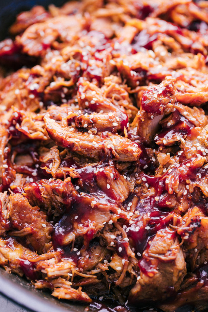 Pulled Pork moist and juicy topped with bbq sauce for the perfect sandwich or taco by The Food Cafe.