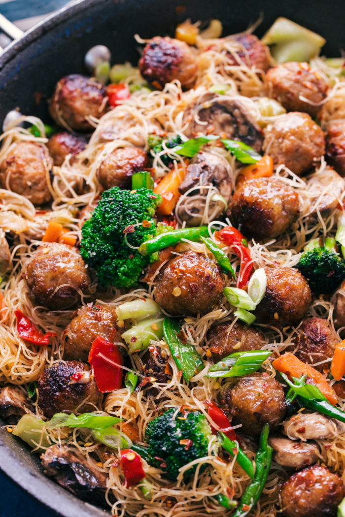 Teriyaki meatballs stir fried and served with noodles in a skillet, by The Food Cafe.