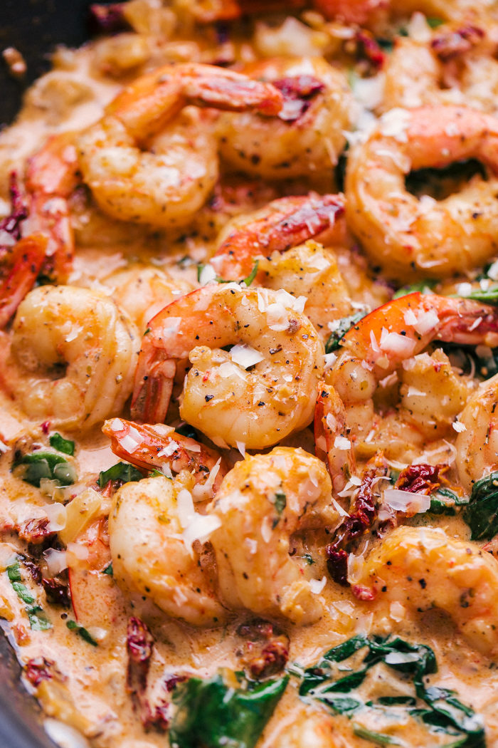 Sun dried tomato garlic shrimp in a creamy sauce with cooked spinach and parmesan cheese by The Food Cafe