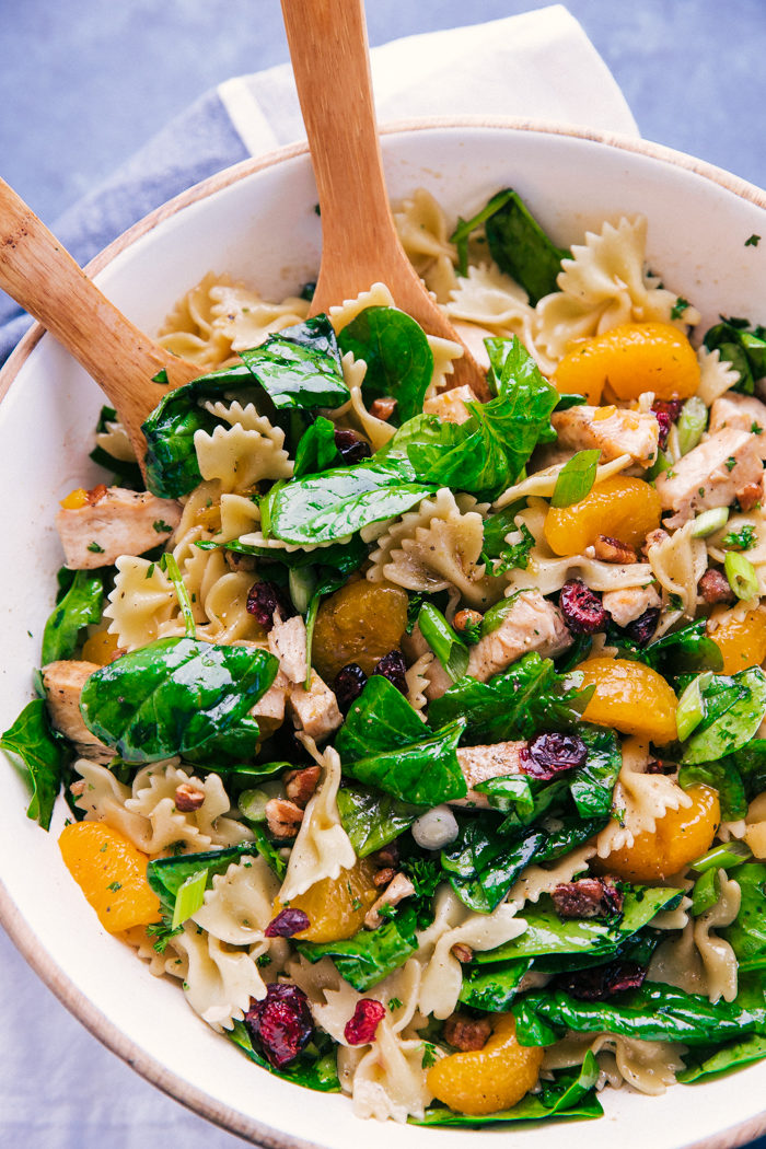 pasta salad made with spinach and chicken tossed with mandarin oranges in a light dressing by the food cafe.