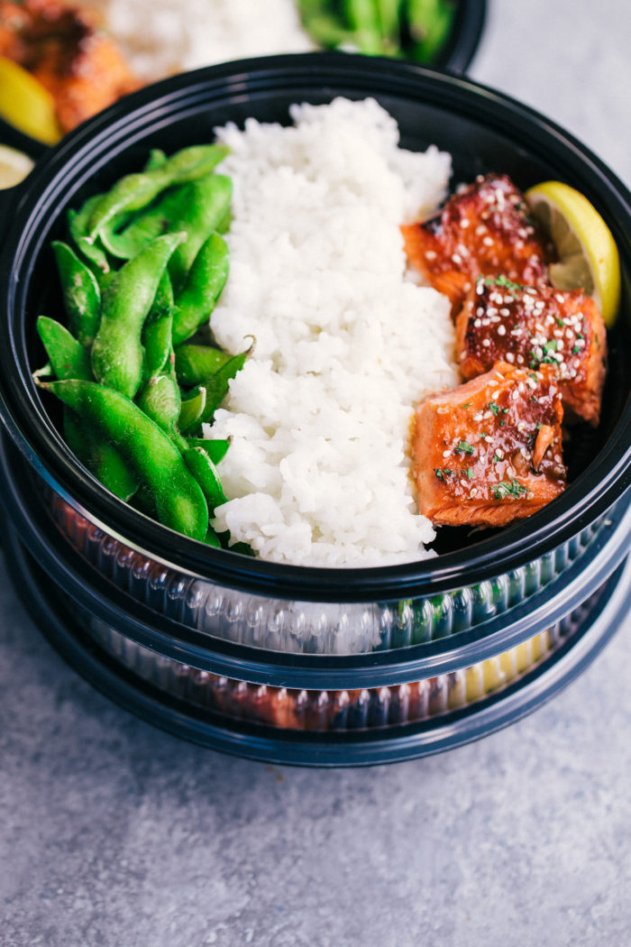 Salmon Meal Prep with white rice and edamame in meal prep containers for clean eating, by The Food Cafe.