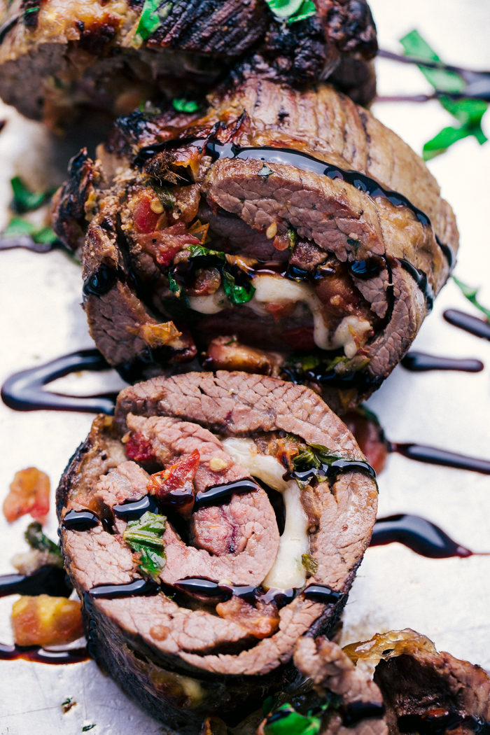how to cook flank steak and make into pinwheels with cheese, tomatoes, basil, and balsamic glaze.