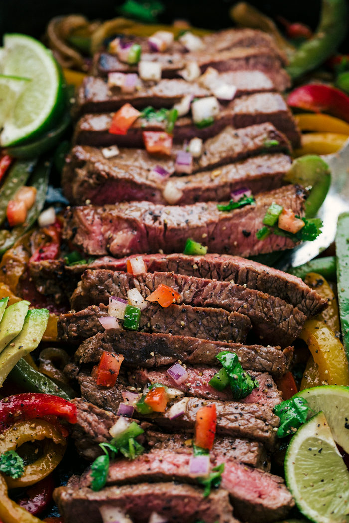 Steak Fajita cut up into strips of meat topped with pico de gallo and served from a skillet by The Food Cafe