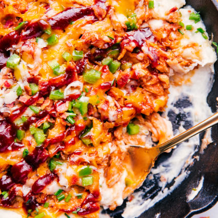 BBQ chicken and mashed potato skillet with gold fork in skillet