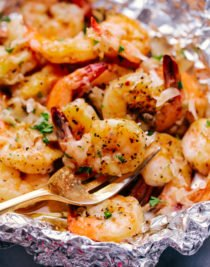 parmesan garlic butter shrimp foil packs with fork
