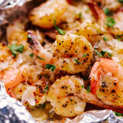 Parmesan Garlic Butter Shrimp Foil Packs close up with parmesan cheese