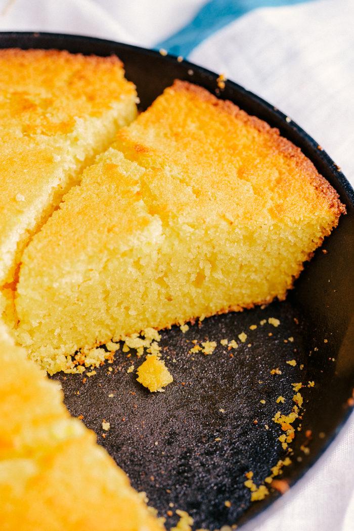 The best skillet cornbread sliced in skillet