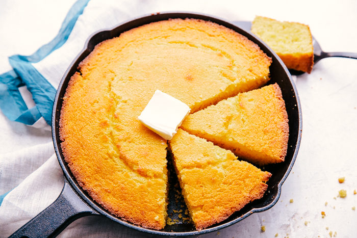 The best skillet cornbread cut in pie shape pieces in a cast iron skillet