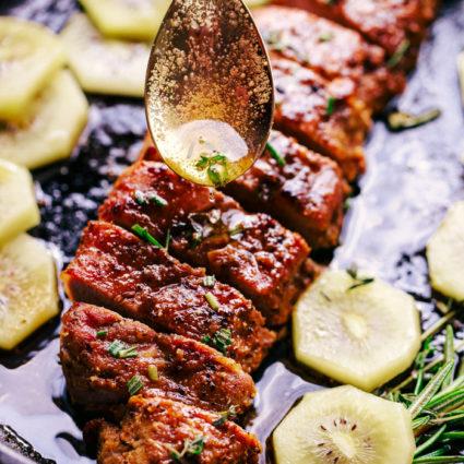 Brown butter pork tenderloin being placed on pork