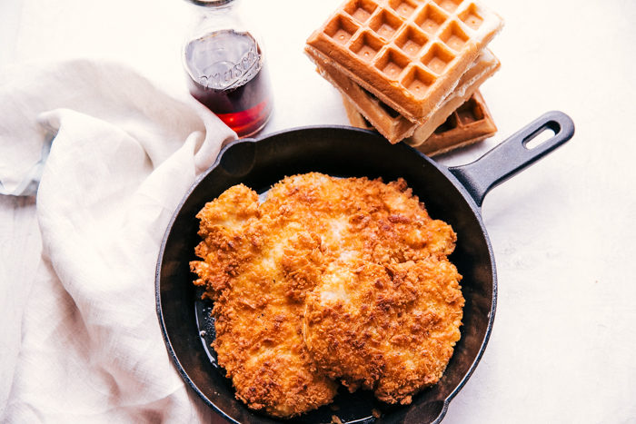 Fried chicken and waffles in a skillet