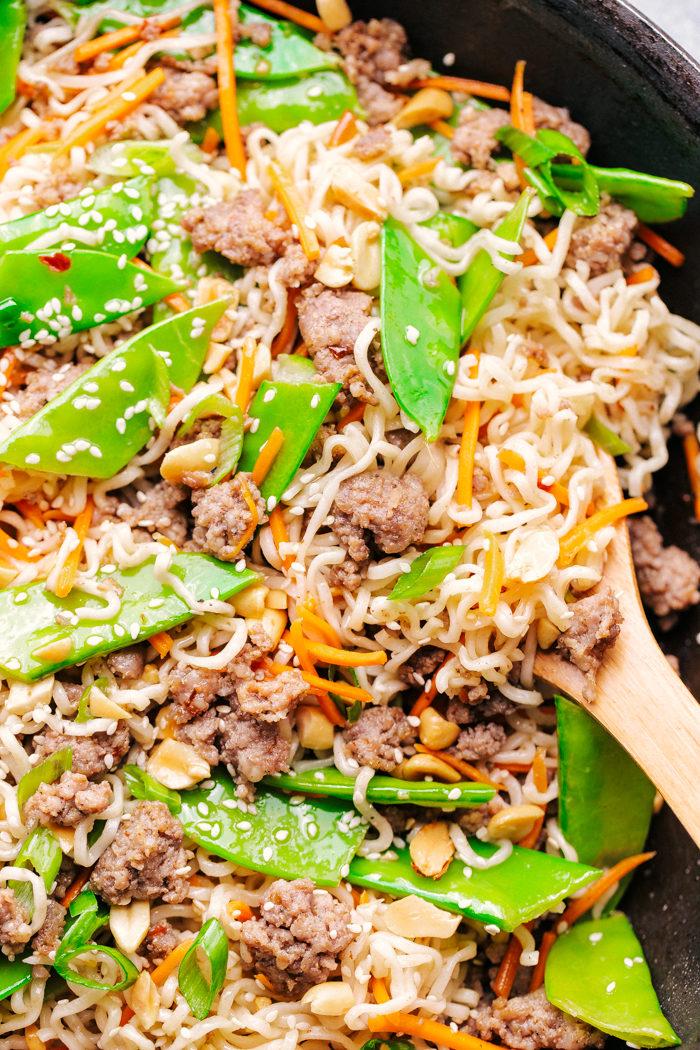 Ramen noodle stir fry in a skillet.