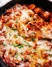 cheesy skillet meatballs served with parmesan cheese and basil topping