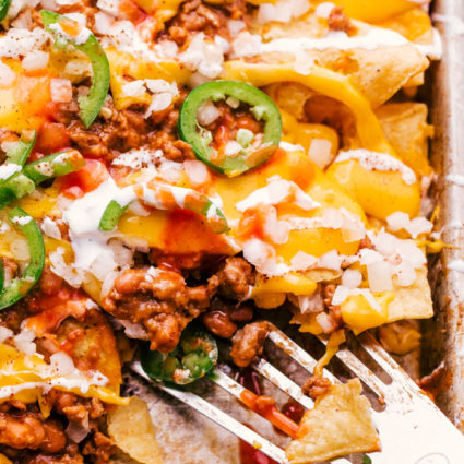 chili cheese nachos served on a sheet pan