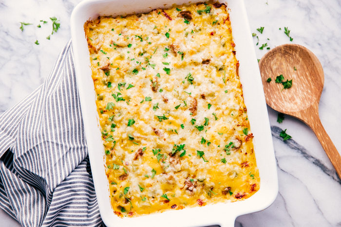Easy sausage casserole being served out of a white casserole dish.