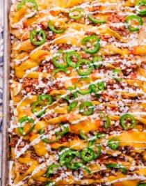 sheet pan chili cheese nachos ready to serve from sheet pan