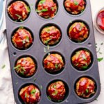 muffin tin meatloaf with bbq sauce being served.