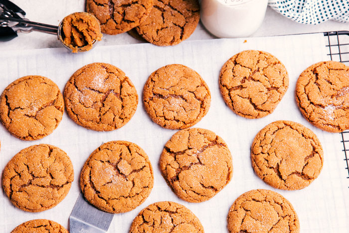 chewy ginger cookies served on a cooking rack with milk.