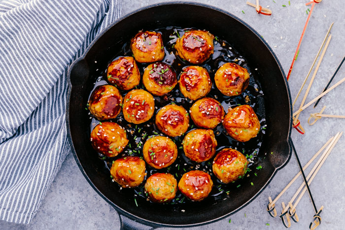 Honey garlic meatballs in a cast iron skillet served with cocktail toothpicks-perfect party appetizer