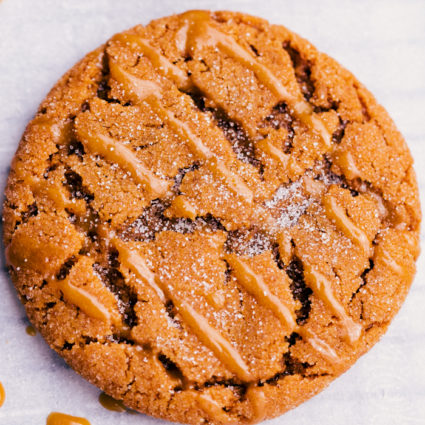 Chewy ginger cookie with molasses glaze drizzled on top.
