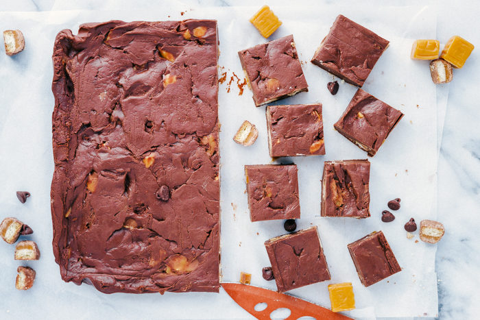 candy bar fudge cut into squares made with Twix candy bars and caramels-loved by kids.