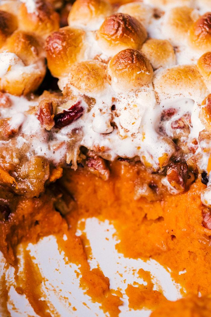 sweet potato casserole layered with pecans and mini marshmallows.
