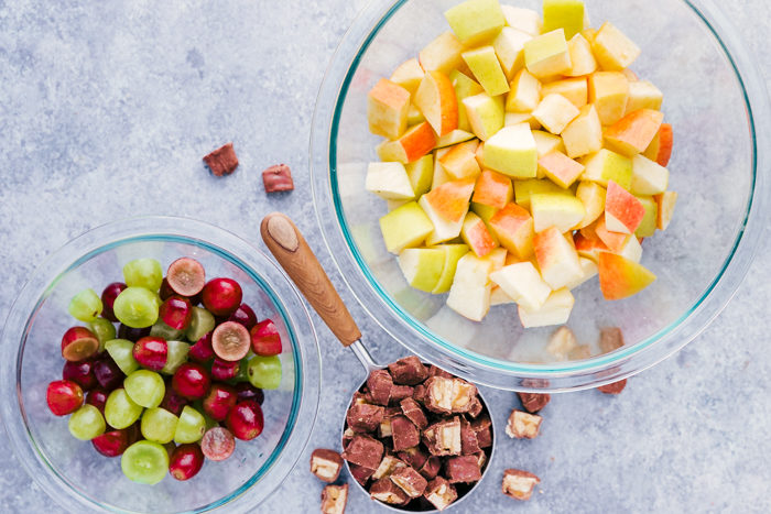 apples, grapes, and snickers to make snickers caramel apple salad.
