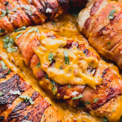 bacon wrapped chicken topped with chili cheese sauce.