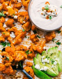 Buffalo Cauliflower Bites served with spicy ranch dip and garnished with blue cheese crumbles, chopped parsley, and spicy ranch dip, by the food cafe