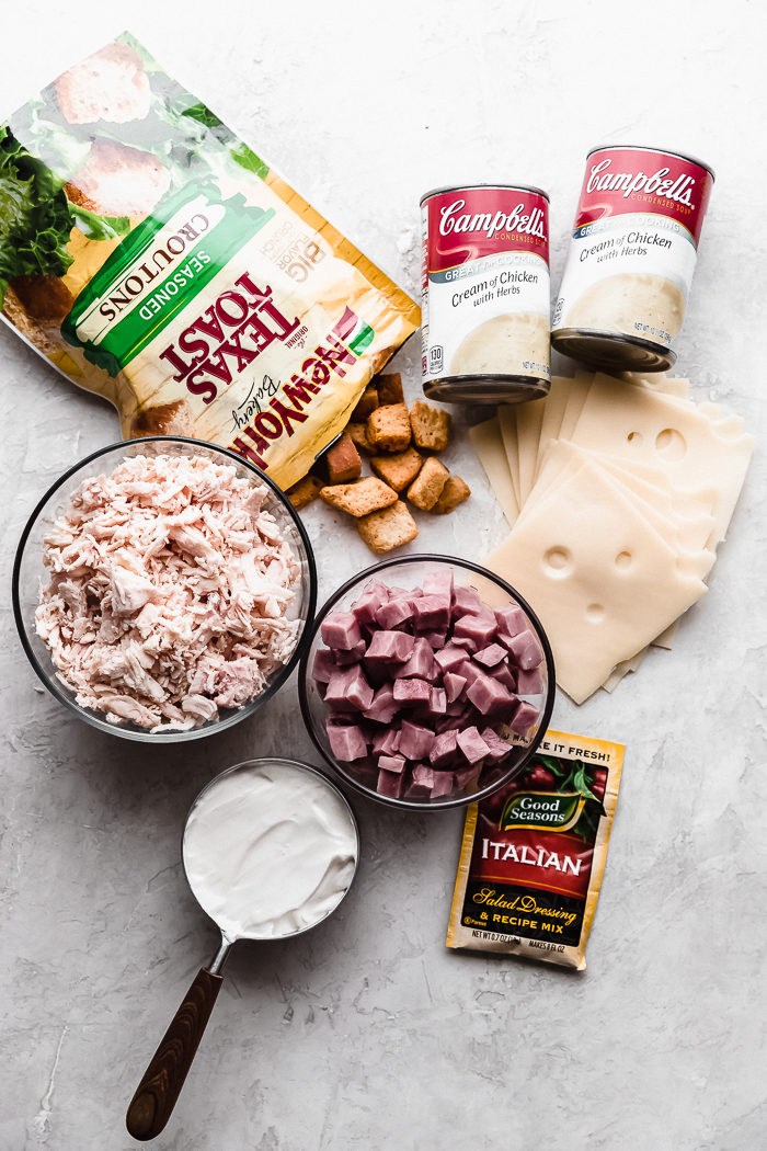 The ingredients needed for the chicken cordon bleu casserole laid on a white background making it easy to see what you need, by The Food Cafe.