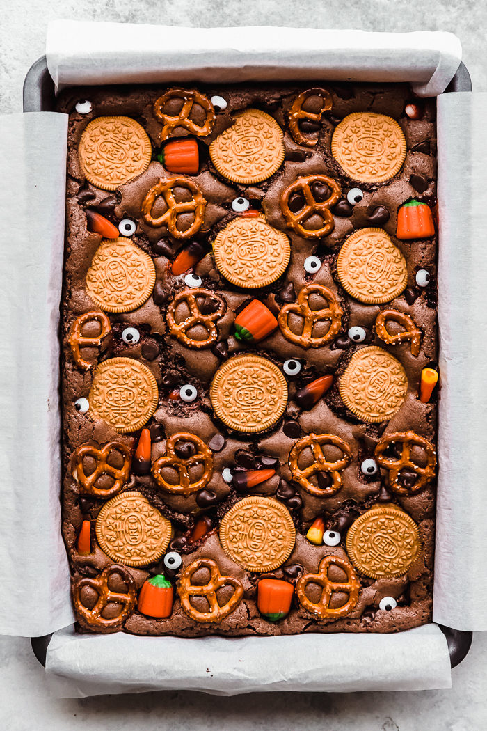 Halloween brownies in a 9x13 baking pan lined with parchment paper by The Food Cafe.