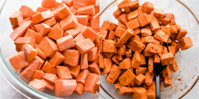 sweet potatoes cut into cubes in a glass mixing bowl with oil and spices added and mixed by The Food Cafe.