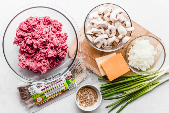 the ingredients needed to make keto cheeseburger muffins on a white background by The Food Cafe.